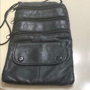 A wristlet black bag with shoulder string